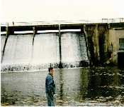 Dad Next To Spillway