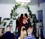 David And Kristen Smooching At Their Wedding